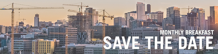 "Seattle skyline with text ""Save the Date"""