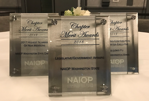 photo of three awards on a table