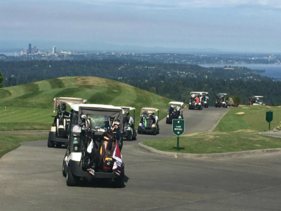 Golfers head out to the course for the 2015 Summer Social